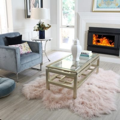 Small pink fluffy rug styled in living room