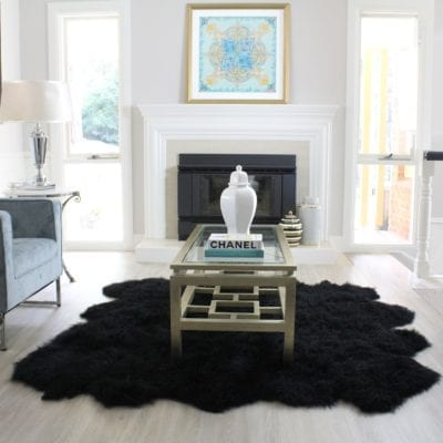 black fur rug styled in living room