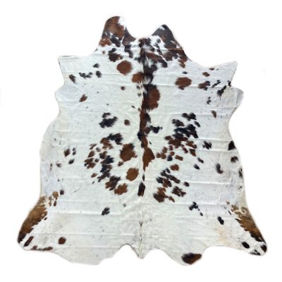 White-cowhide-rug-brown-spot