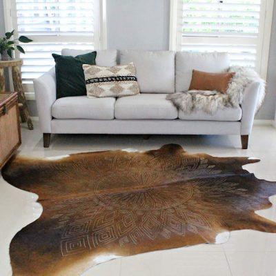Tan cowhide rug - laser etched